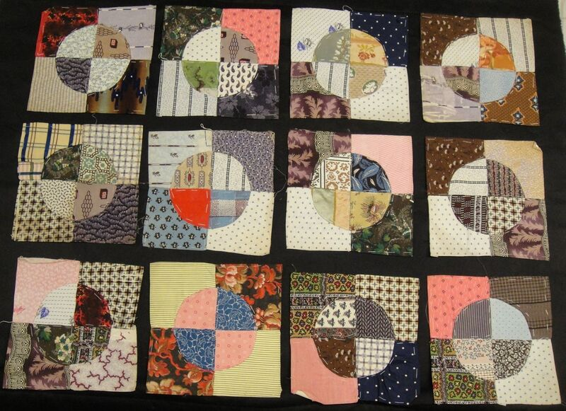 Twelve patchwork pieces in different colours and prints
