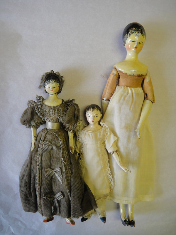 Three wooden dolls, British, 1810-1850, 1922.171, 173 and 174.